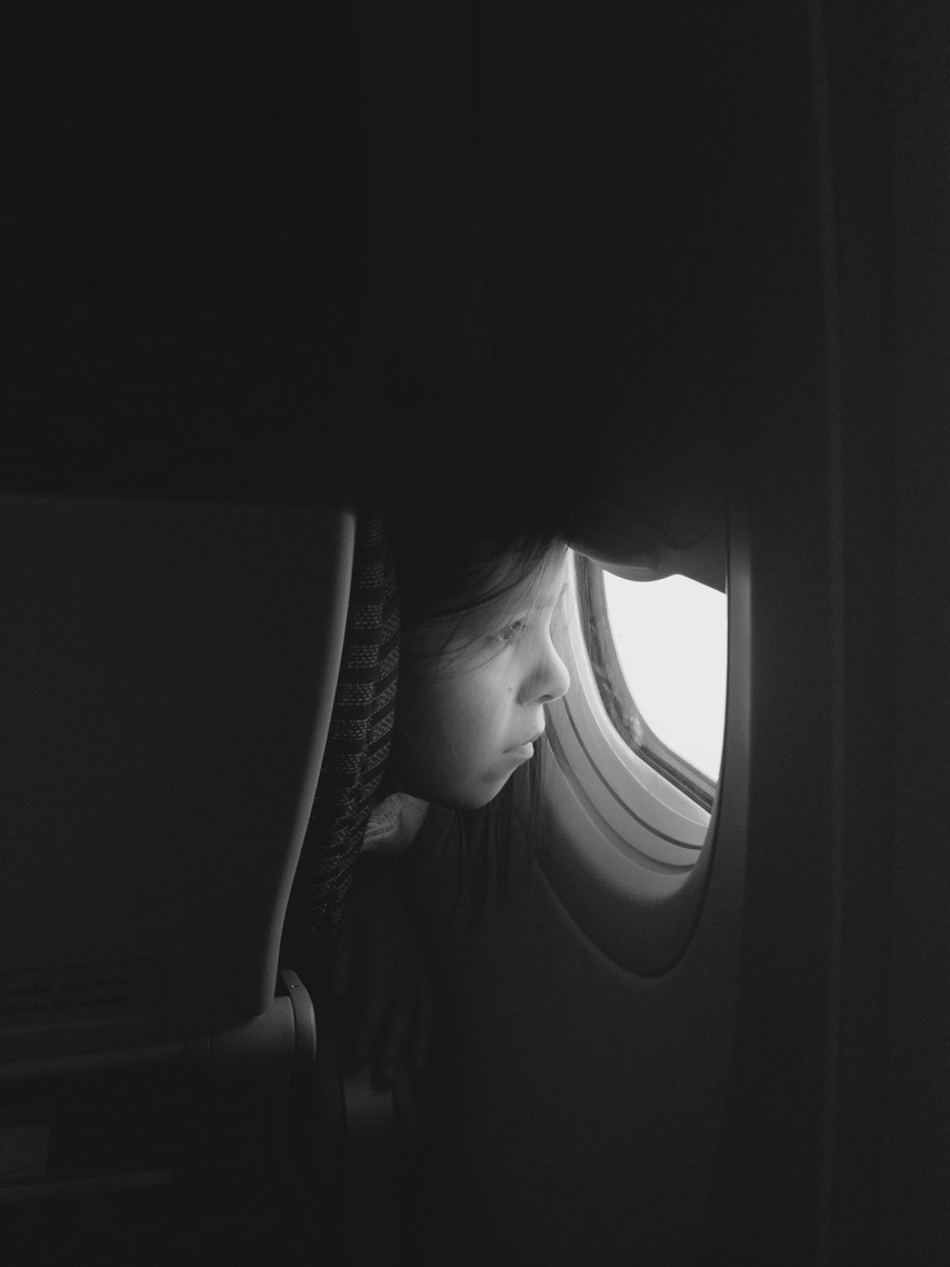 GirlOnPlane_FirstTimeCuriousity_Portrait_Travel
